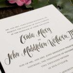 Letterpress wedding invitation with black ink on white cotton paper.